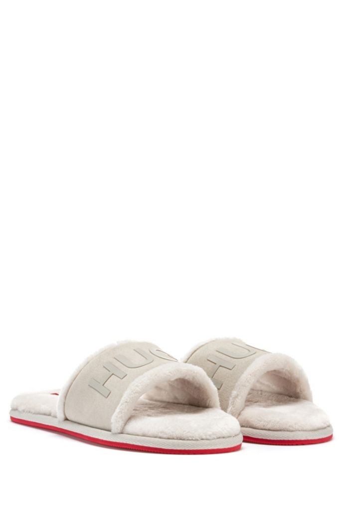 Slide-style logo slippers with split-leather uppers