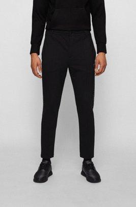 Pantaloni della tuta relaxed fit con motivo grafico riflettente ispirato al tema della collezione, Nero