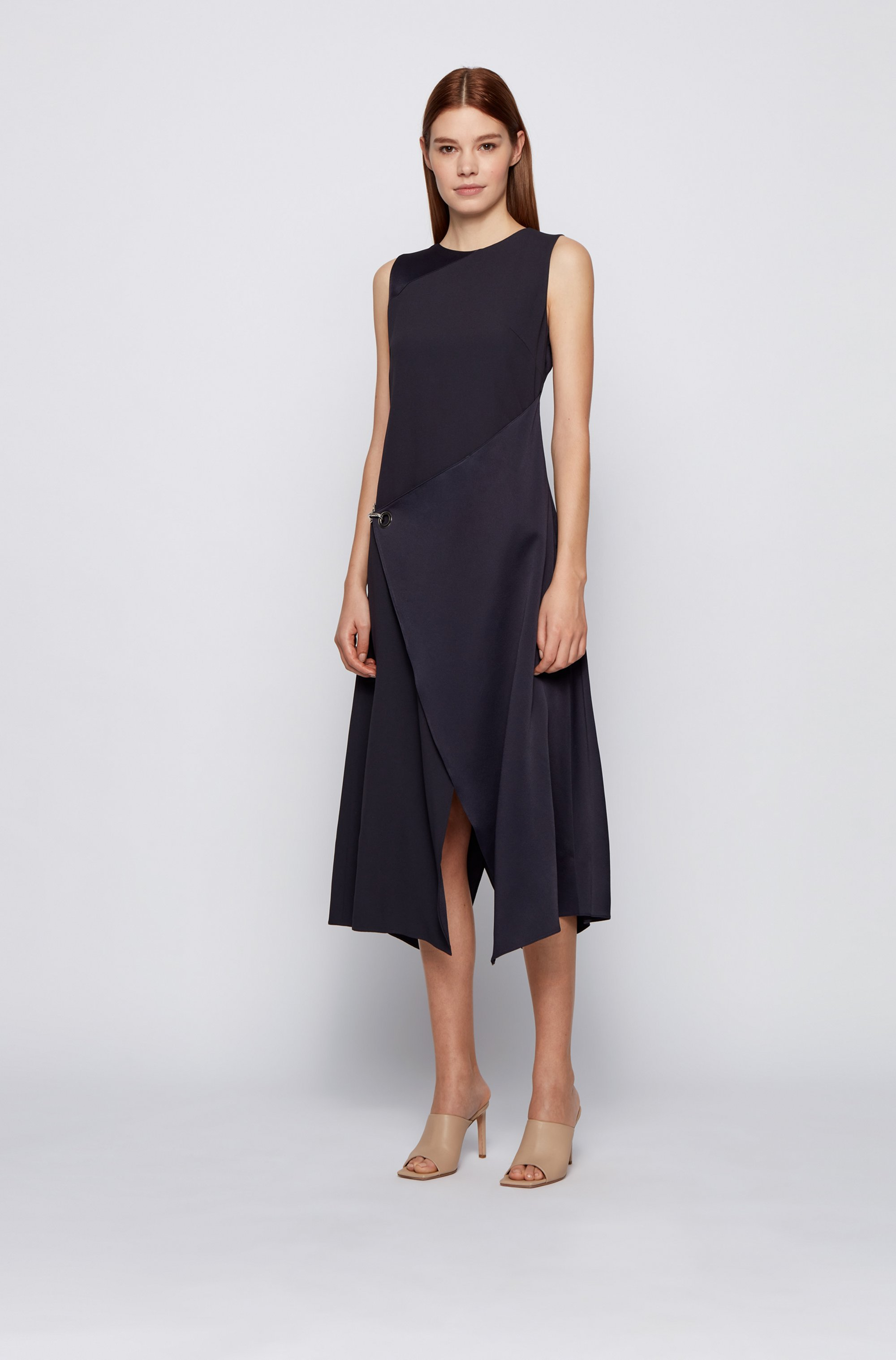 Sleeveless shift dress with asymmetric skirt and hardware trim