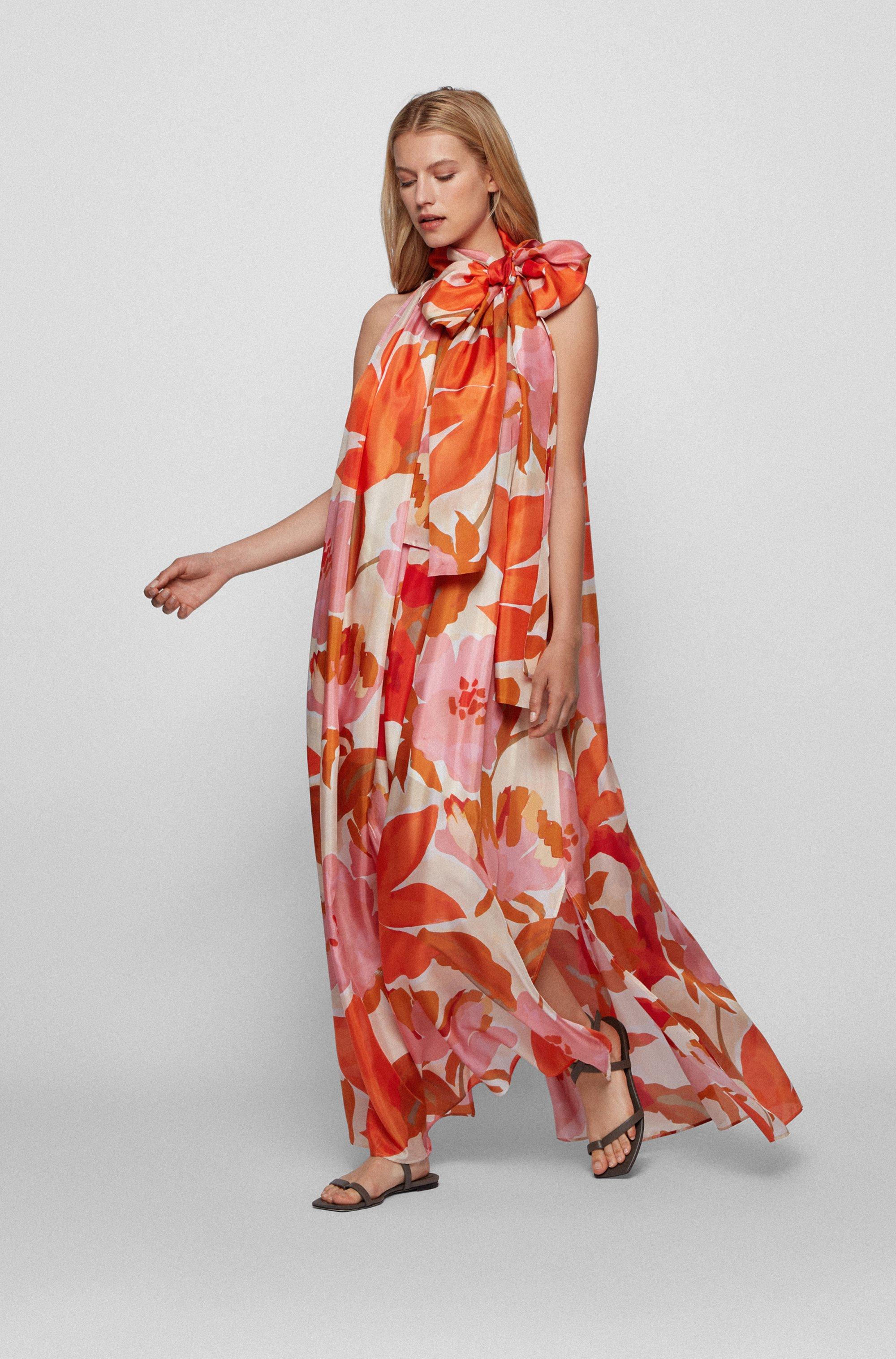 Maxi-jurk van zijde met print en strikhals