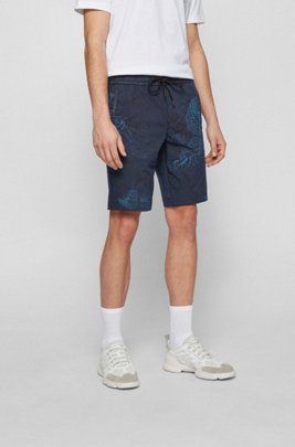 Slim-fit shorts in lightweight fabric with botanical print, Blue Patterned
