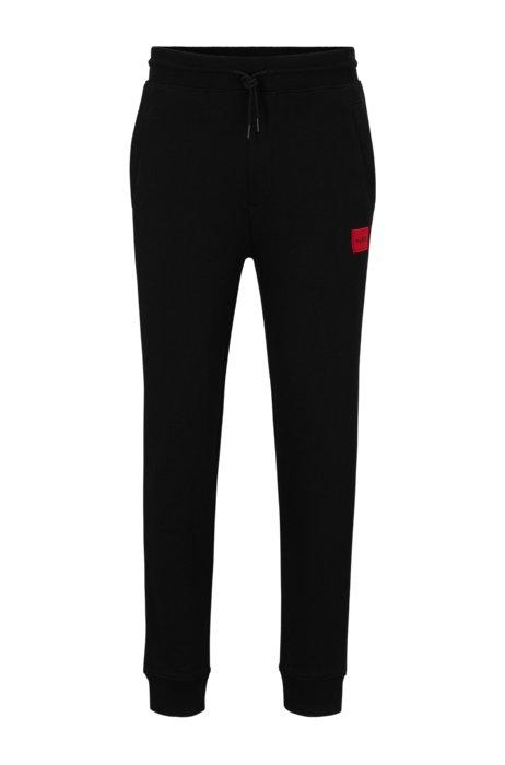 Trainingsbroek van katoen met rode logopatch, Zwart