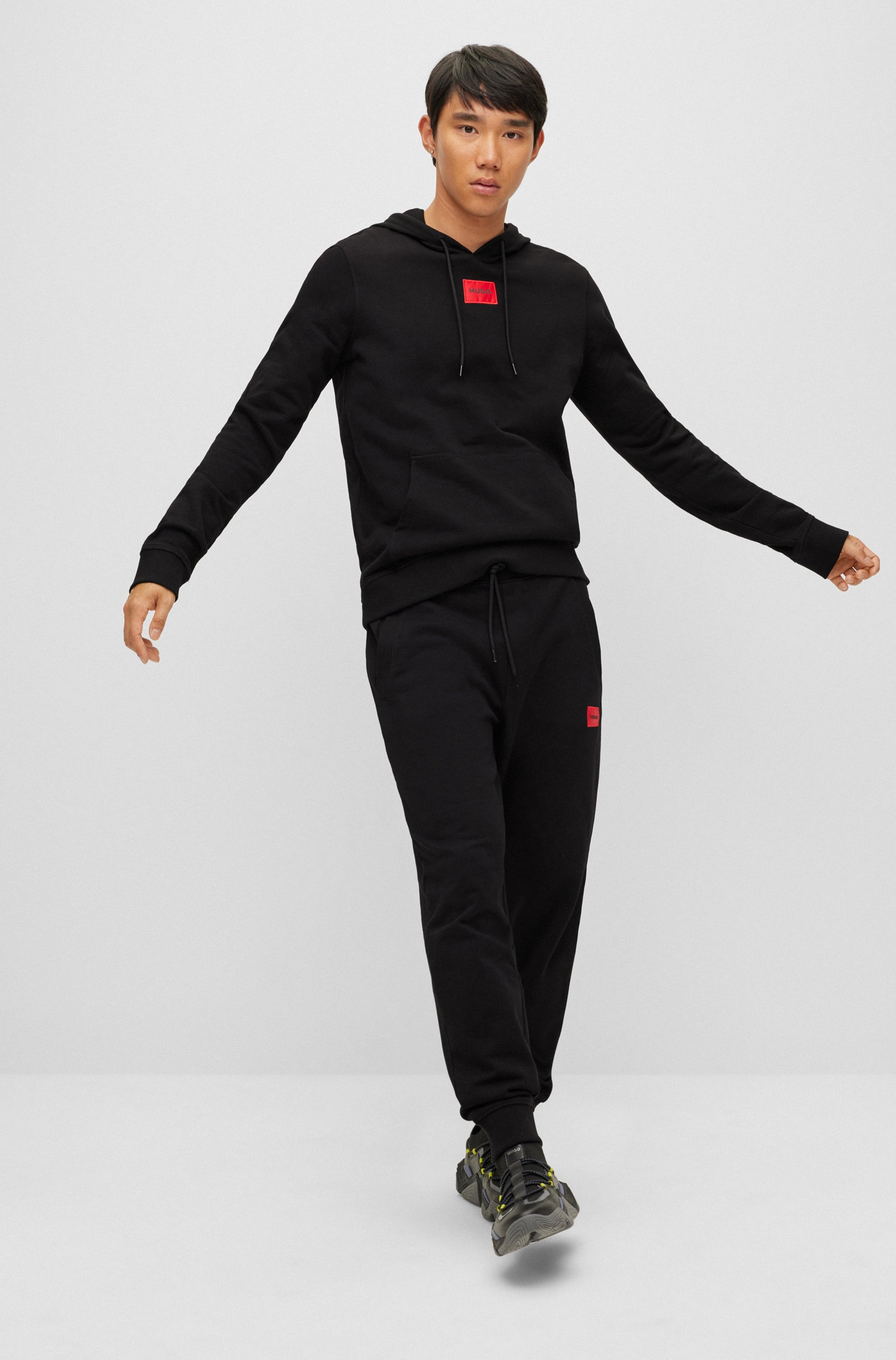 Cotton tracksuit bottoms with red logo patch