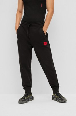Cotton tracksuit bottoms with red logo patch, Black
