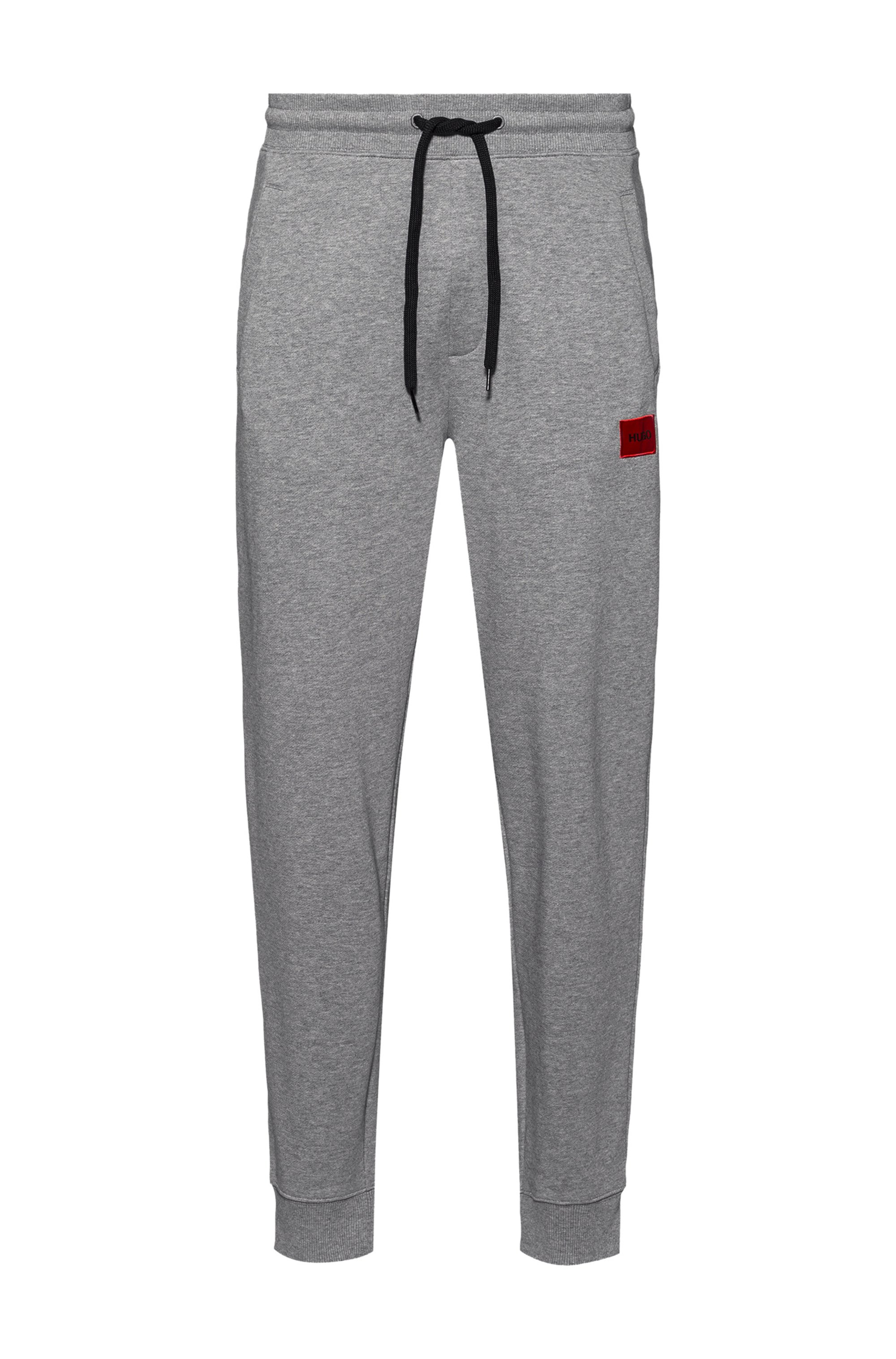 Cotton tracksuit bottoms with red logo patch, Grey