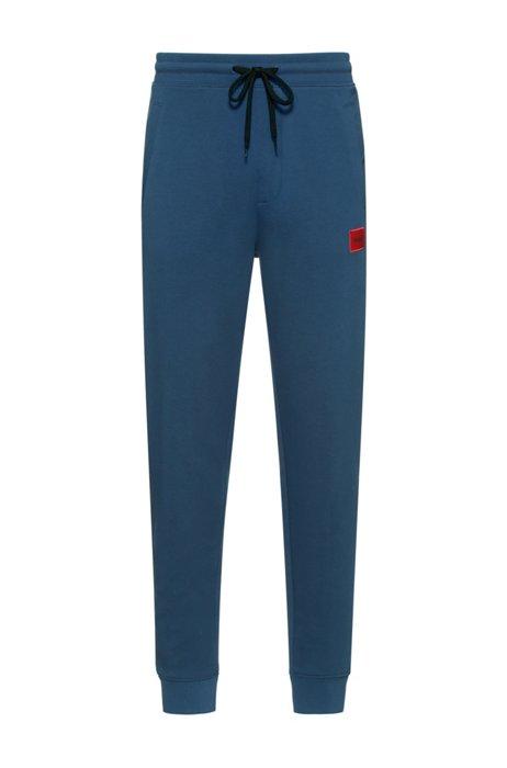 Trainingsbroek van katoen met rode logopatch, Donkerblauw
