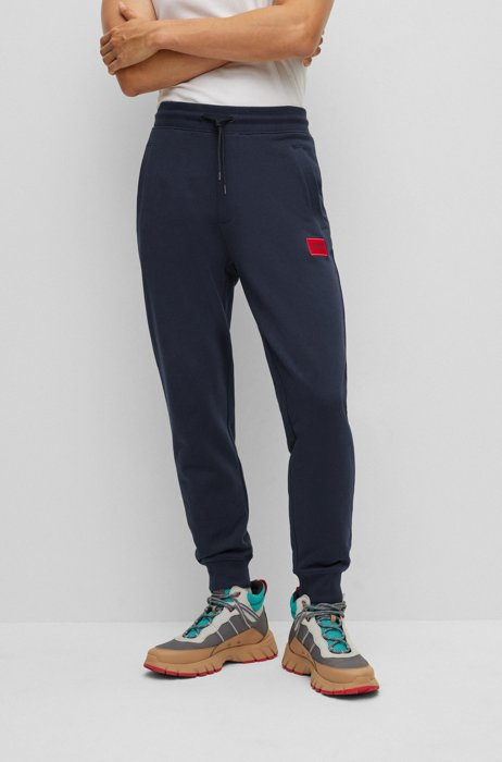 Cotton tracksuit bottoms with red logo patch, Dark Blue