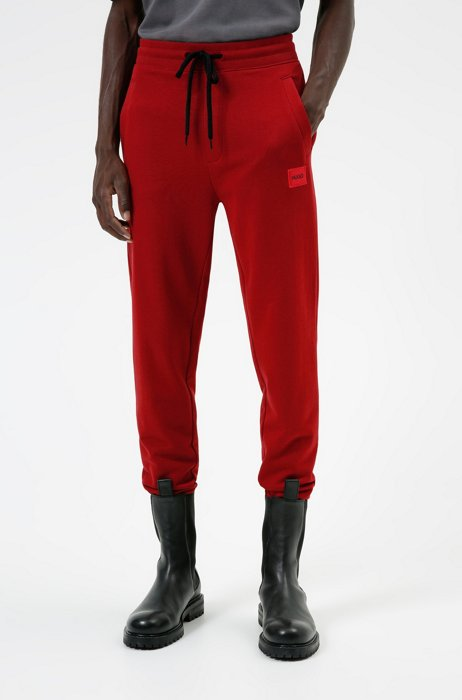 Cotton tracksuit bottoms with red logo patch, Red