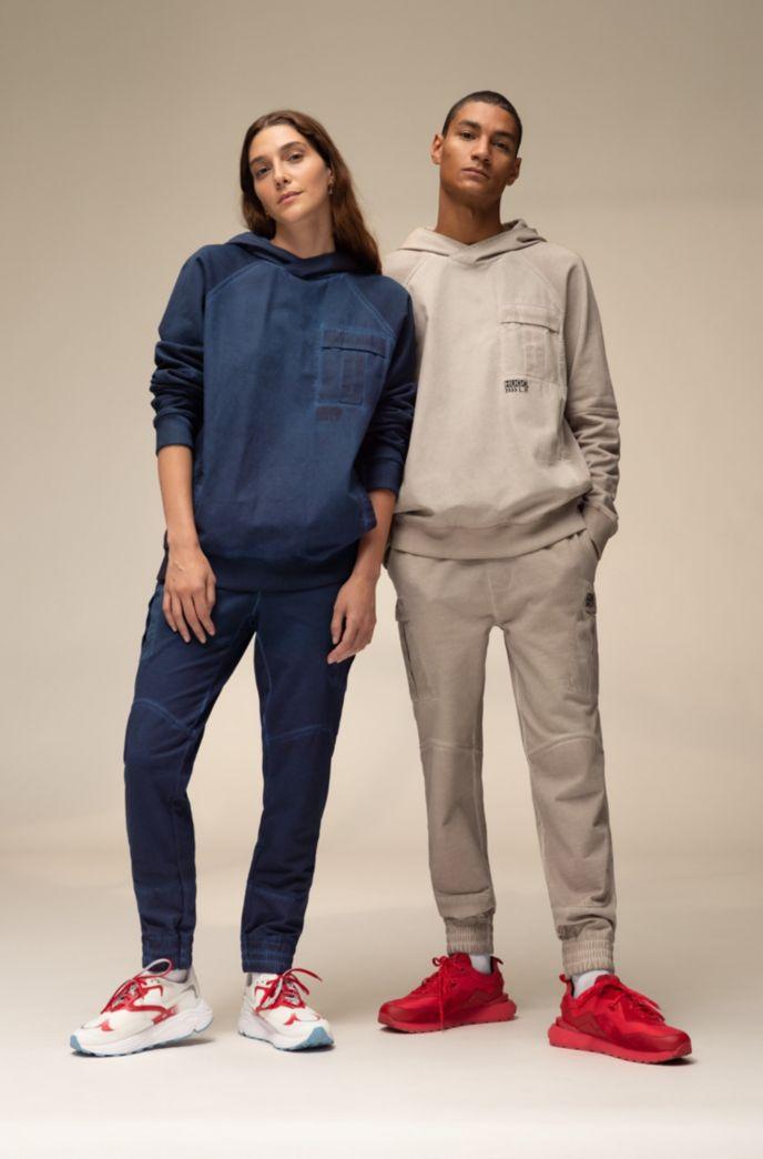 Unisex-Kapuzen-Sweatshirt aus Baumwolle mit Chevron-Logo