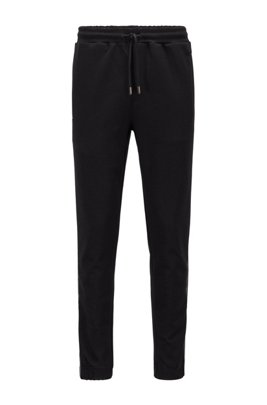 Cotton-blend tracksuit bottoms with gold logo detailing, Black