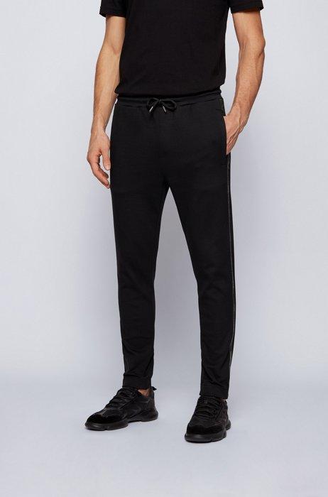 Cotton-blend tracksuit bottoms with gold logo detailing, Black