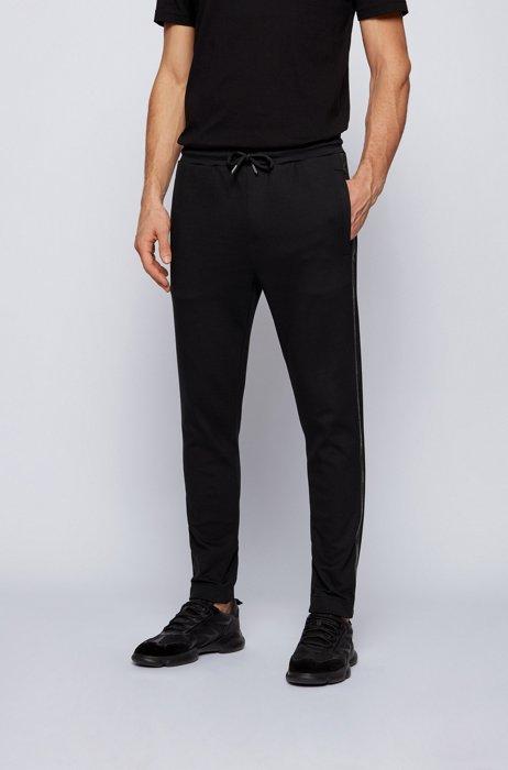 Cotton-blend tracksuit bottoms with logo detailing, Black