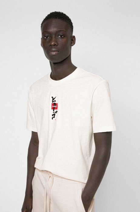 Enzyme-washed cotton T-shirt with logo and calligraphy artwork, White