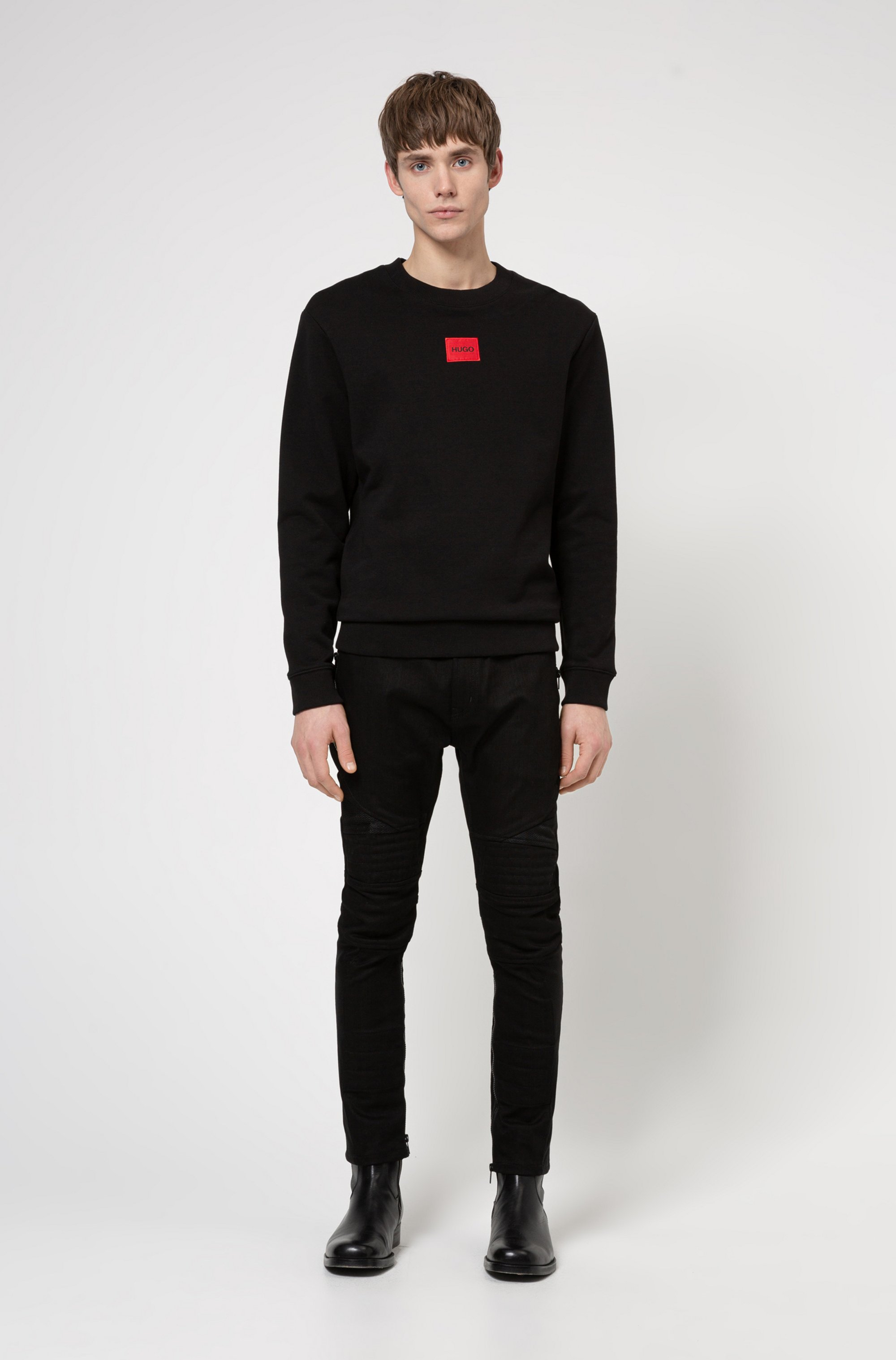 Extra-slim-fit black jeans with mesh and stitching