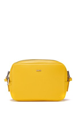 Cross-body grained-leather bag with oval hardware trims, Yellow