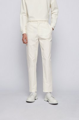 Tapered-fit trousers in crinkled cotton-blend fabric, White