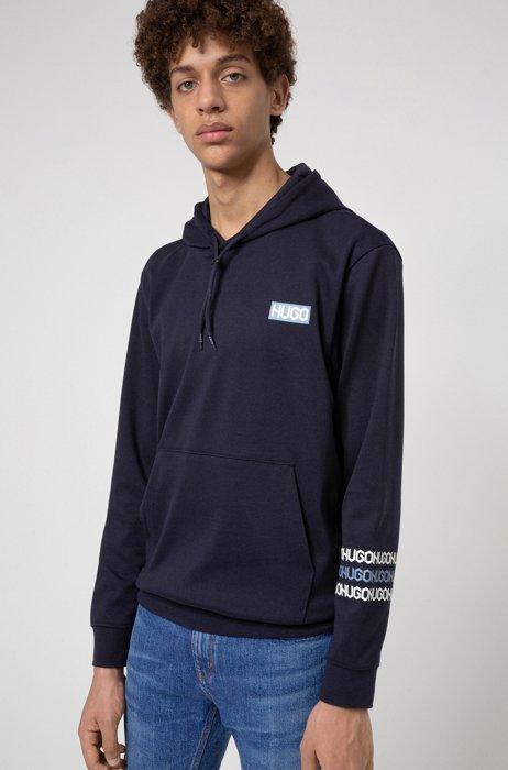 Sweater met capuchon van katoenen sweatstof met logoprints in bandafdruk-stijl, Donkerblauw