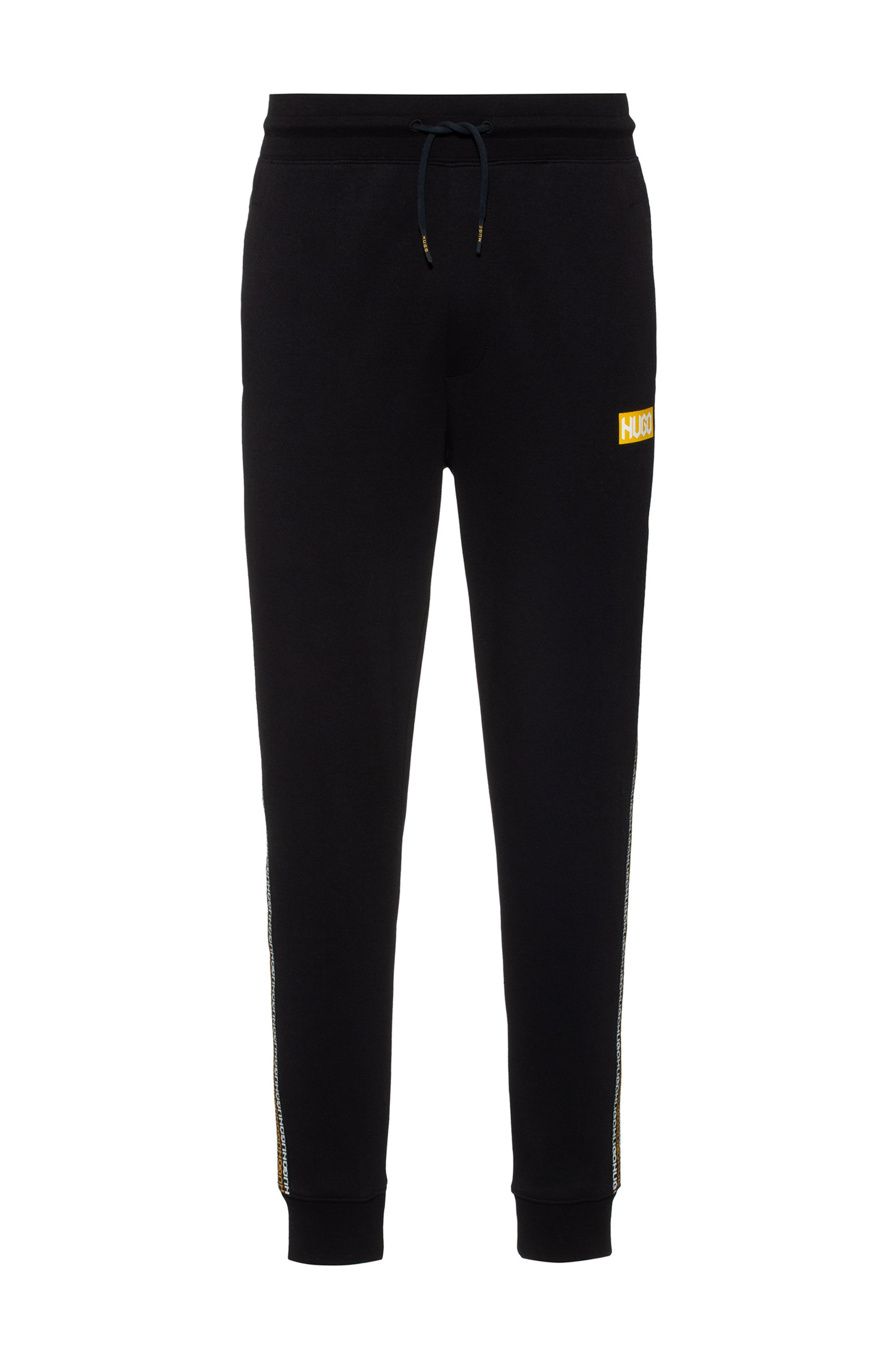 Cotton-terry tracksuit bottoms with tyre-print logos, Black