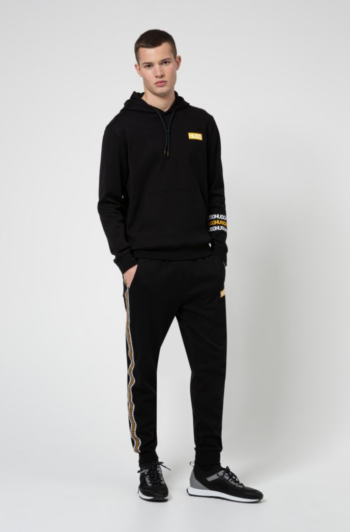 Cotton-terry tracksuit bottoms with tyre-print logos