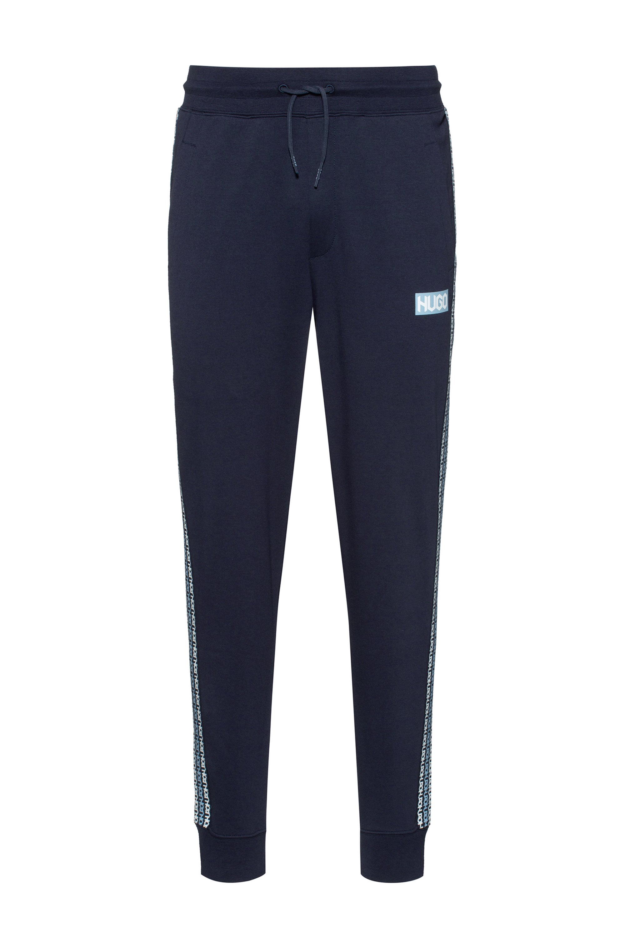 Cotton-terry tracksuit bottoms with tyre-print logos, Dark Blue