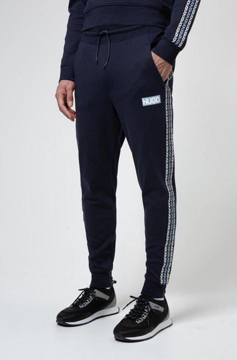 Bas de survêtement en molleton de coton avec logos imprimé pneu, Bleu foncé
