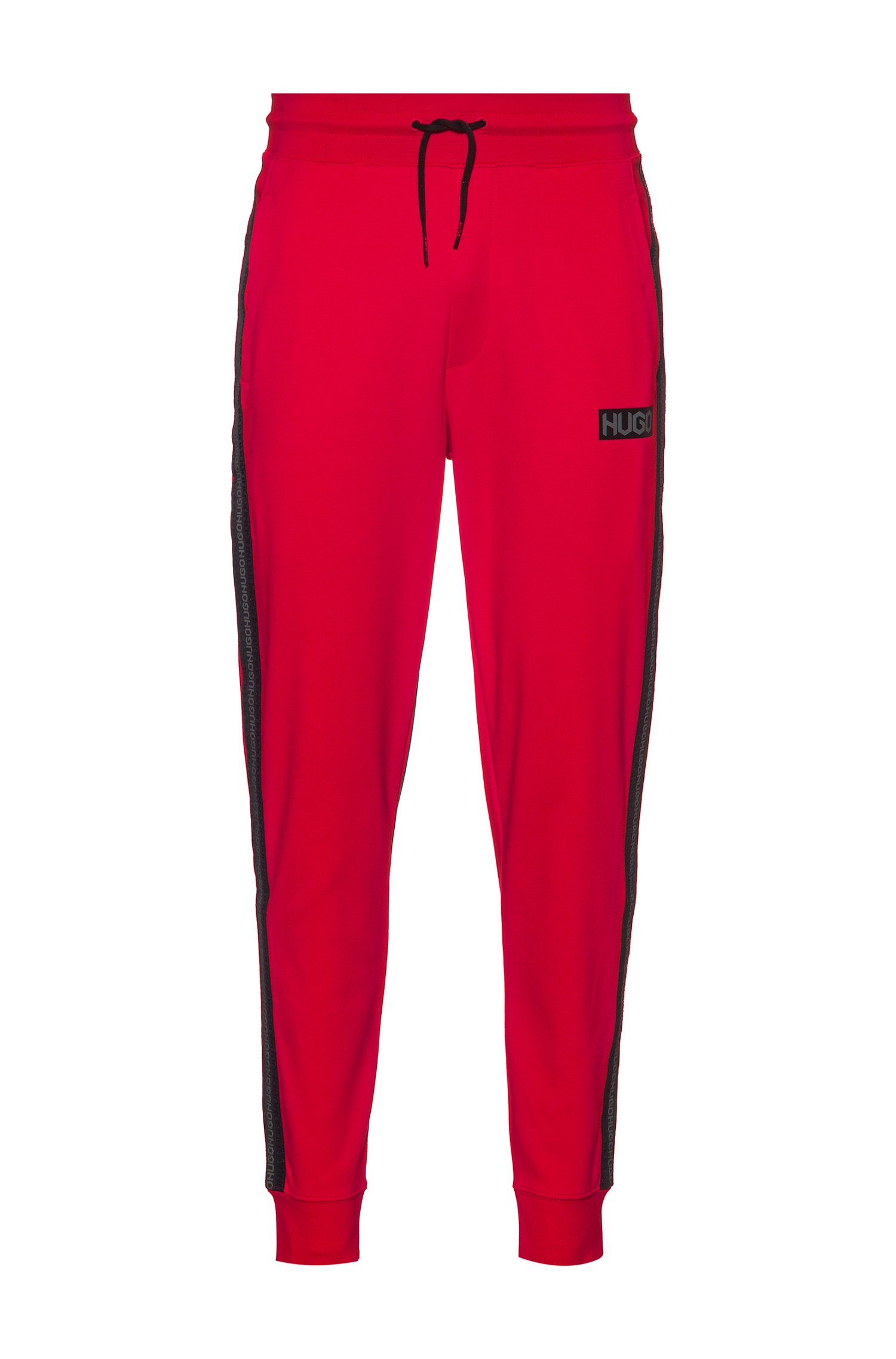 Cotton-terry tracksuit bottoms with tyre-print logos, Red
