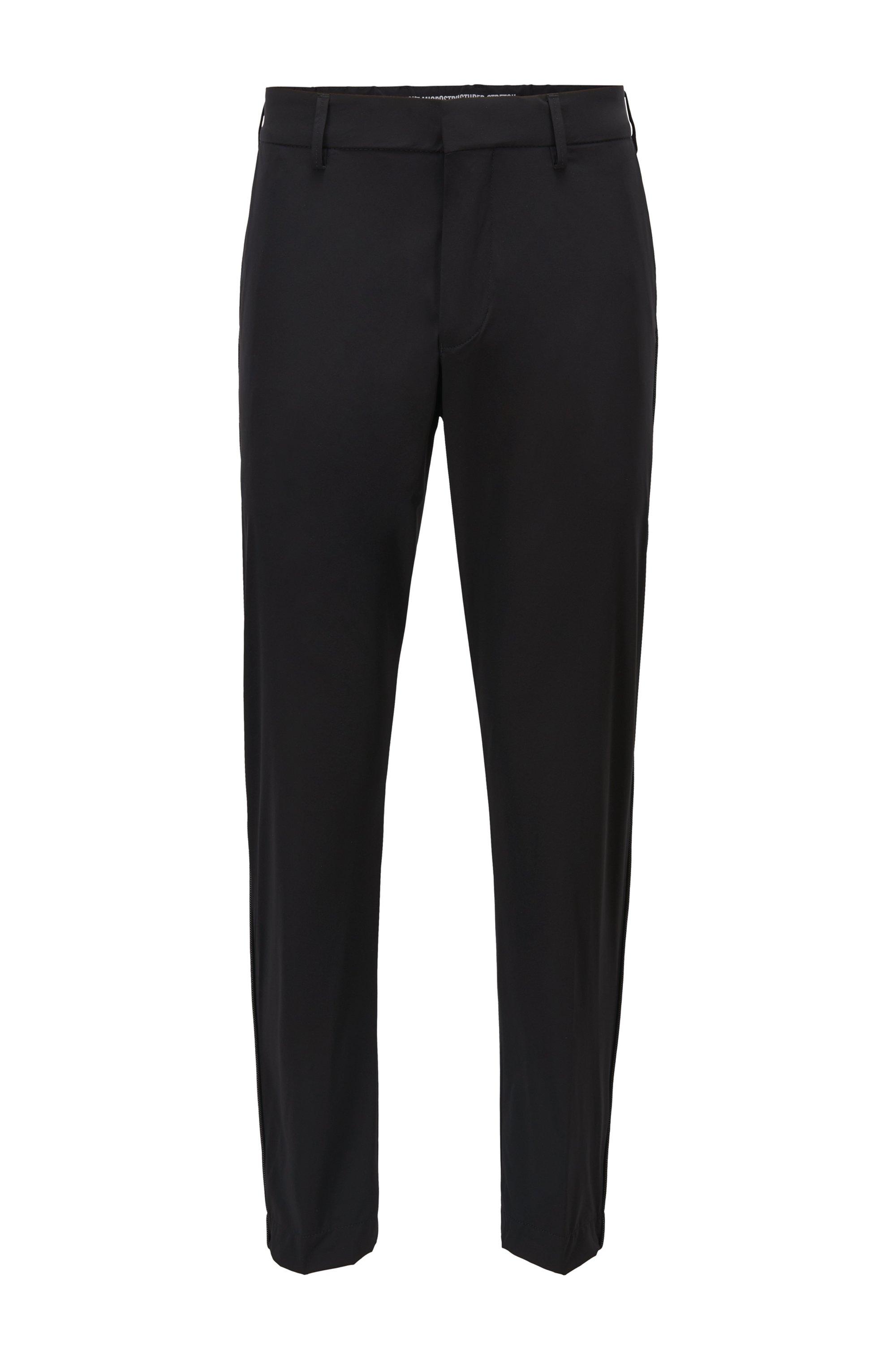 Pantaloni idrorepellenti dal fit affusolato con profili in rete riflettente, Nero