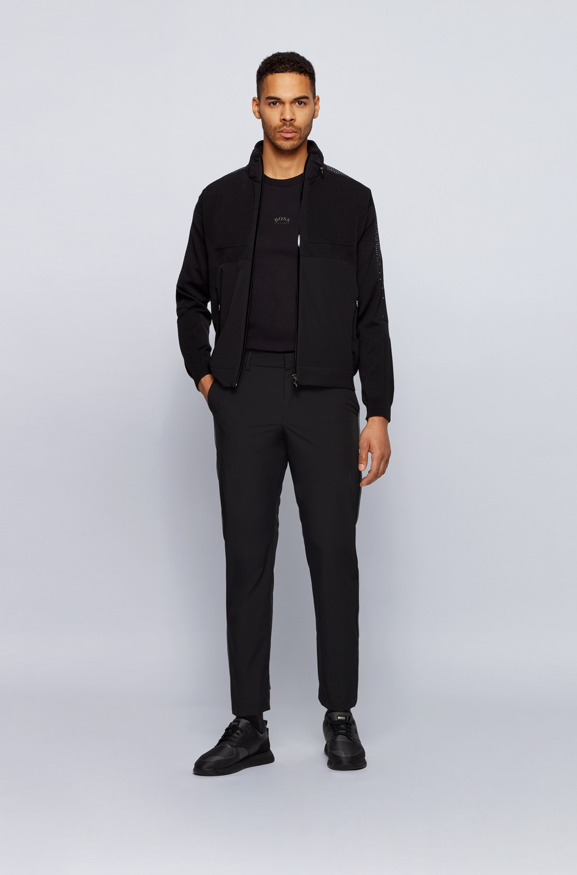 Water-repellent tapered-fit trousers with reflective mesh piping