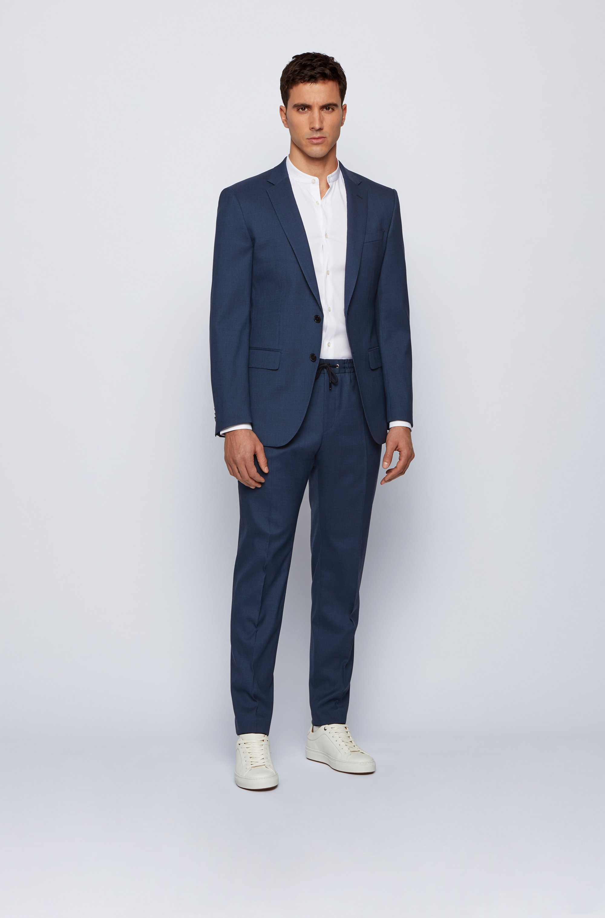 Slim-fit trousers in a wool blend with drawstring waist