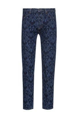 Tapered-fit jeans in blue denim with lasered artwork, Blue Patterned