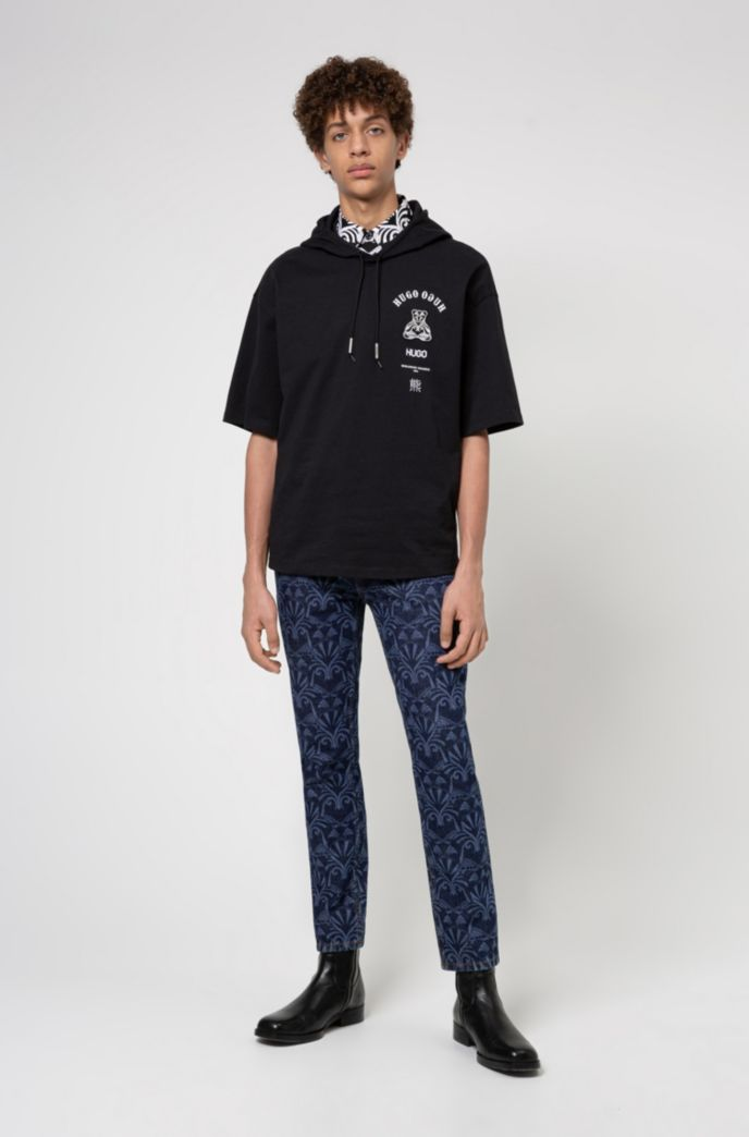 Tapered-fit jeans in blue denim with lasered artwork