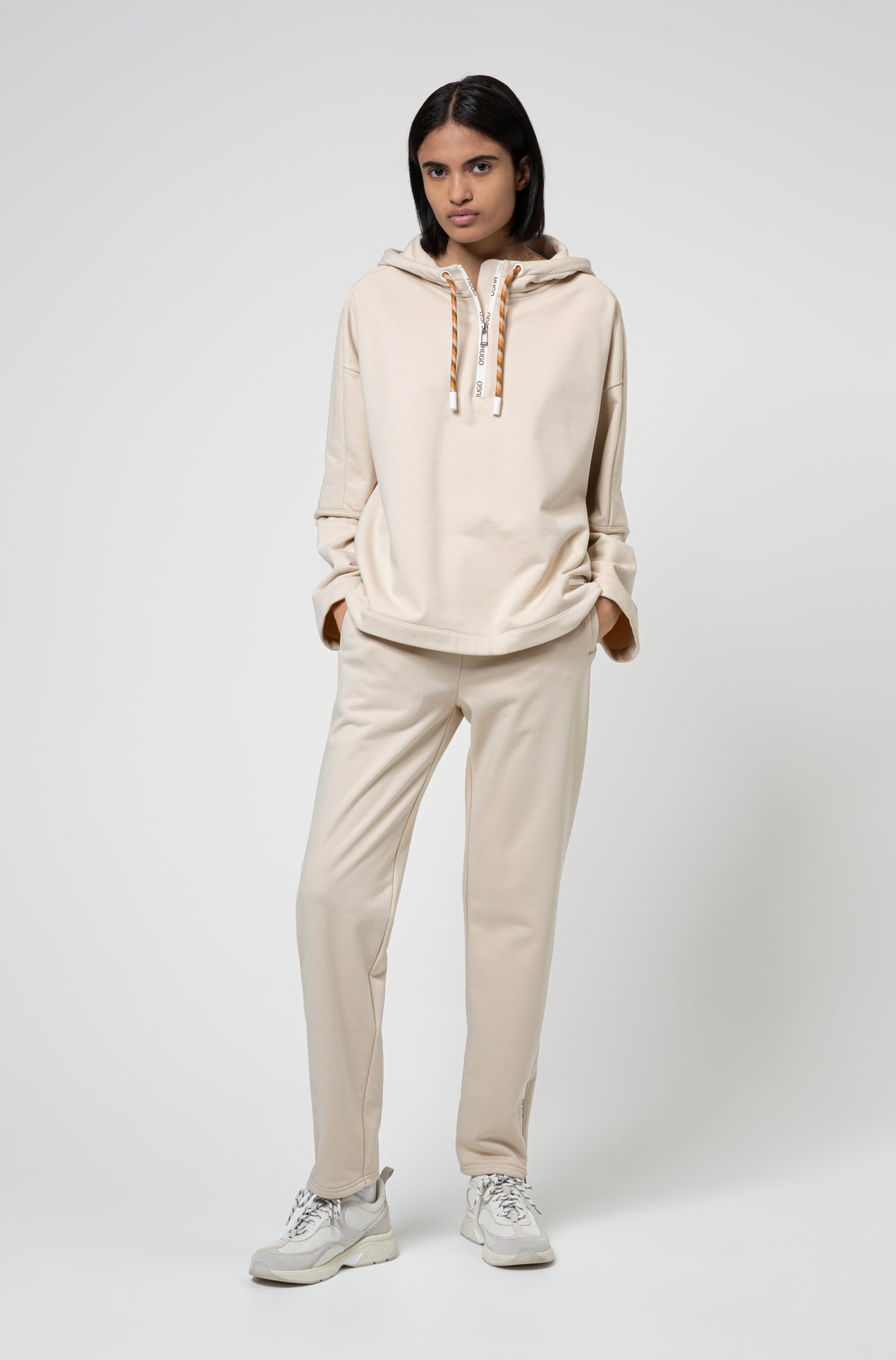 Tapered-fit tracksuit bottoms with zipped hems