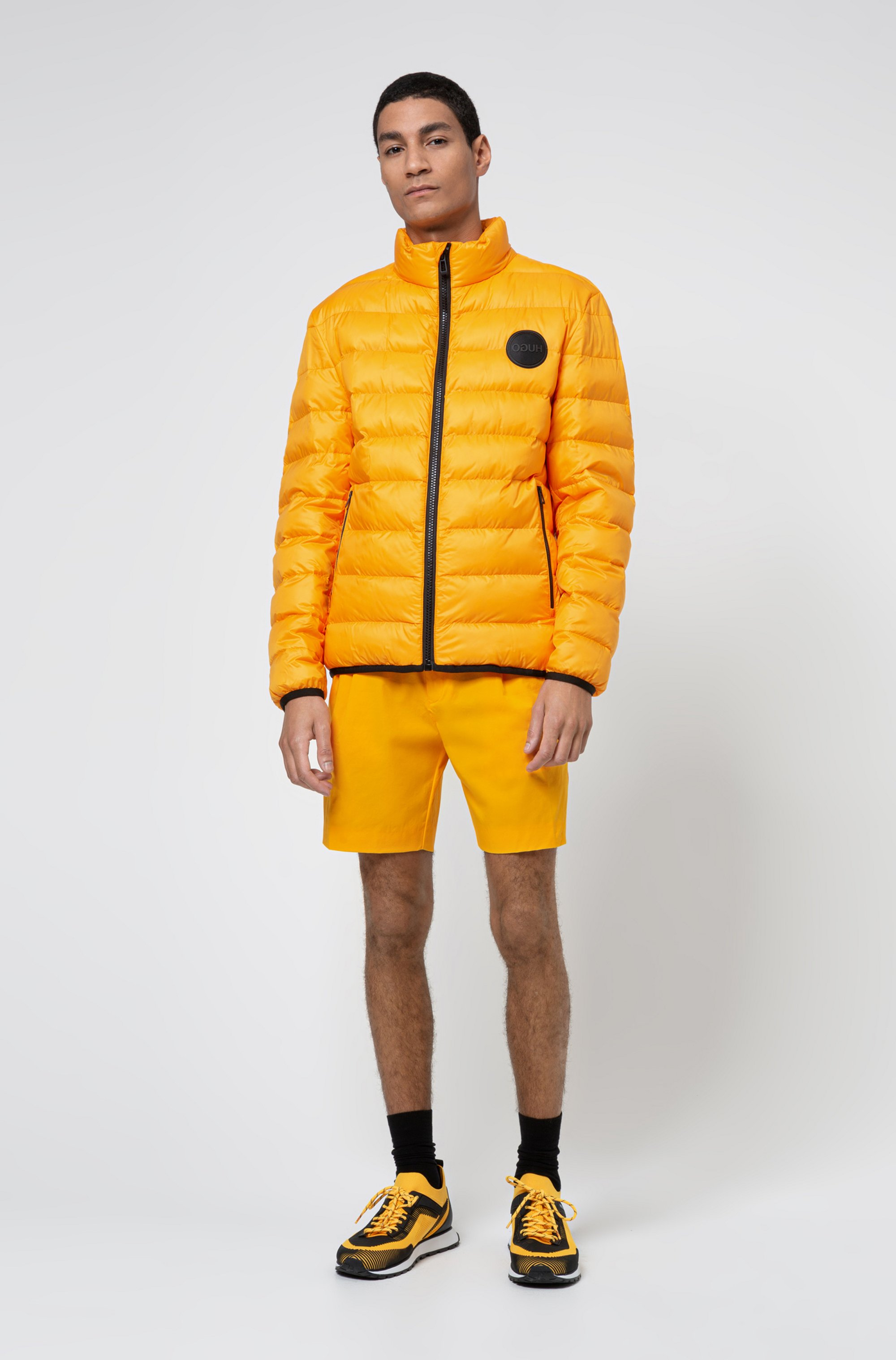 Recycled-fabric puffer jacket with reverse-logo patch