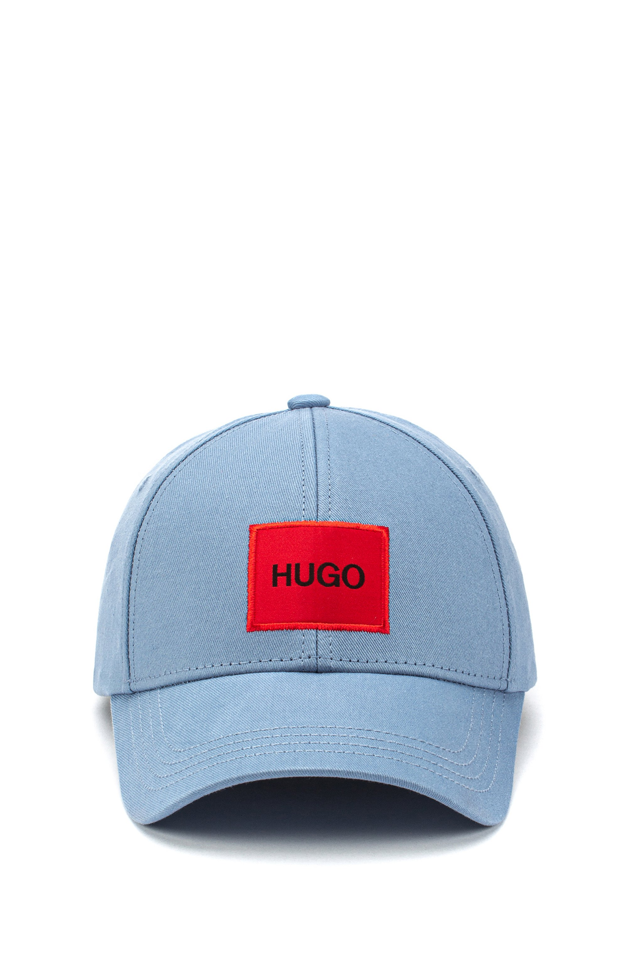 Cap in cotton twill with red logo label