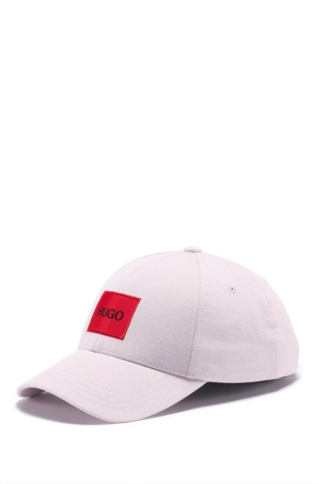 Cap in cotton twill with red logo label, light pink