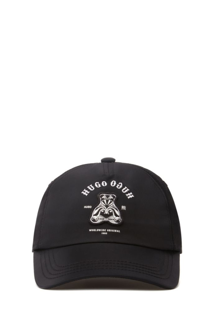Twill cap with bear motif and mirrored lettering