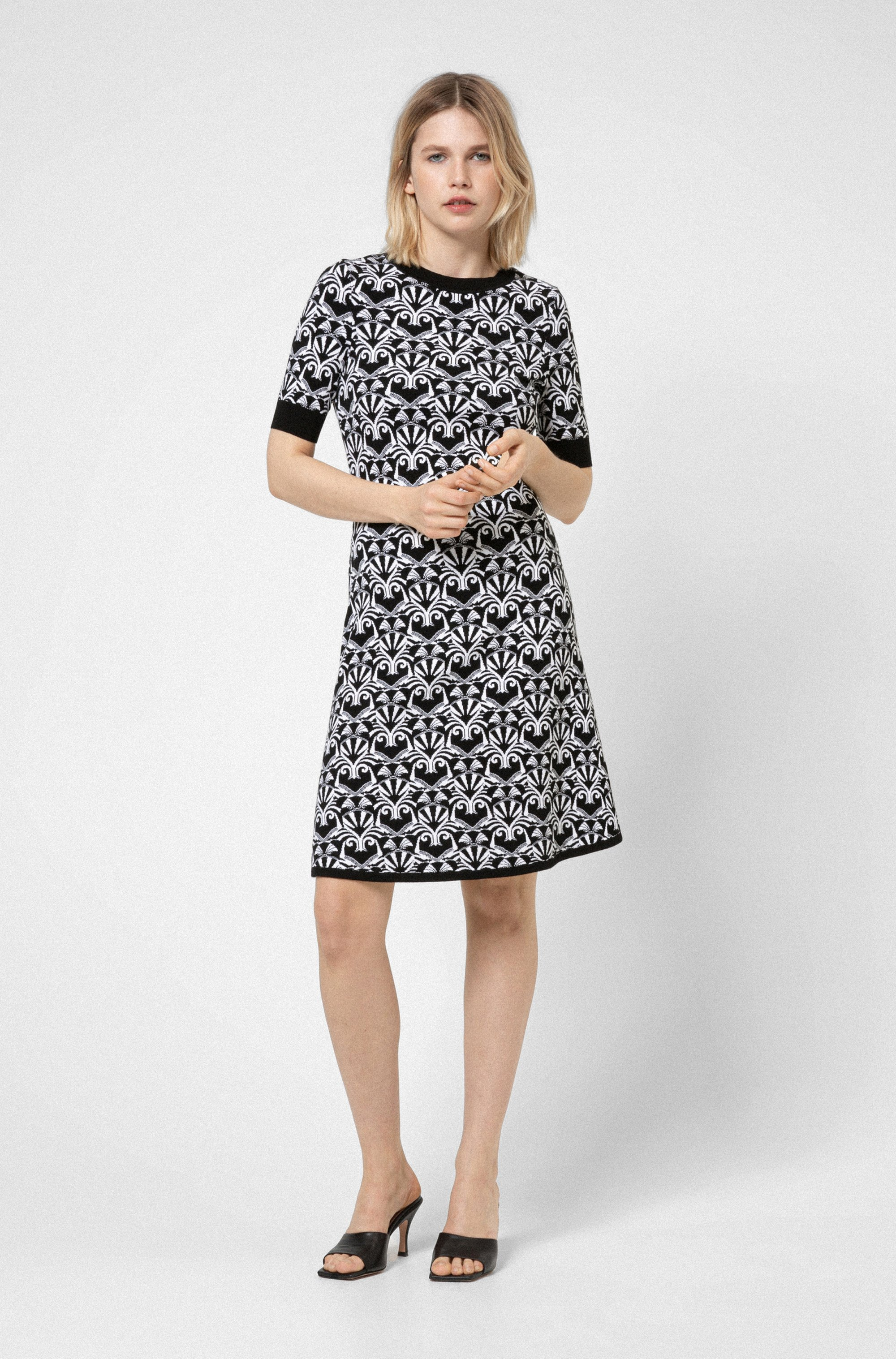 Slim-fit knitted dress with bear motifs