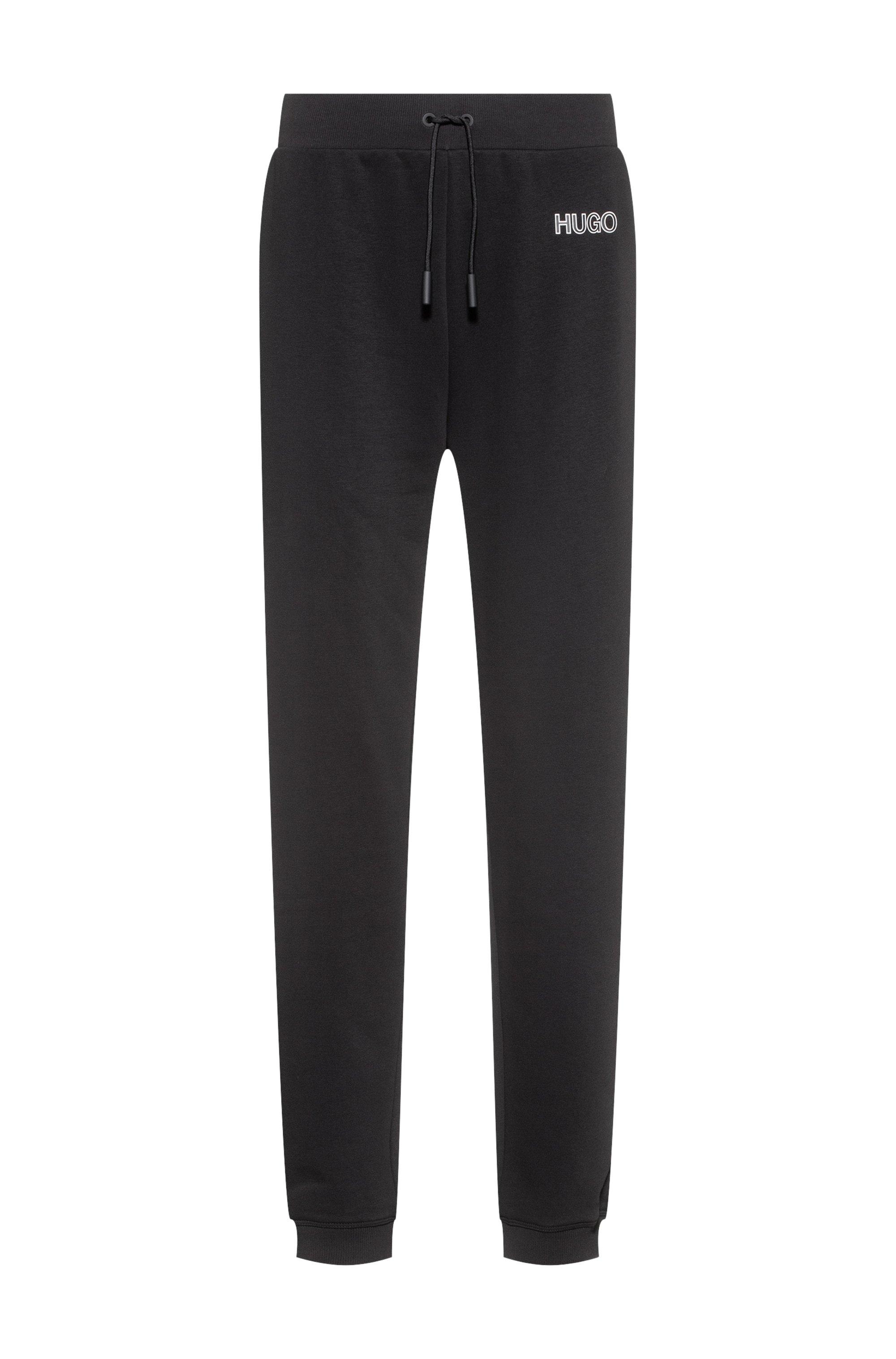 Jogginghose mit Beinbündchen und 3D-Logo aus Silikon, Schwarz