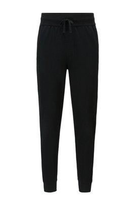 Cuffed-hem loungewear trousers with heat-sealed logo artwork, Black