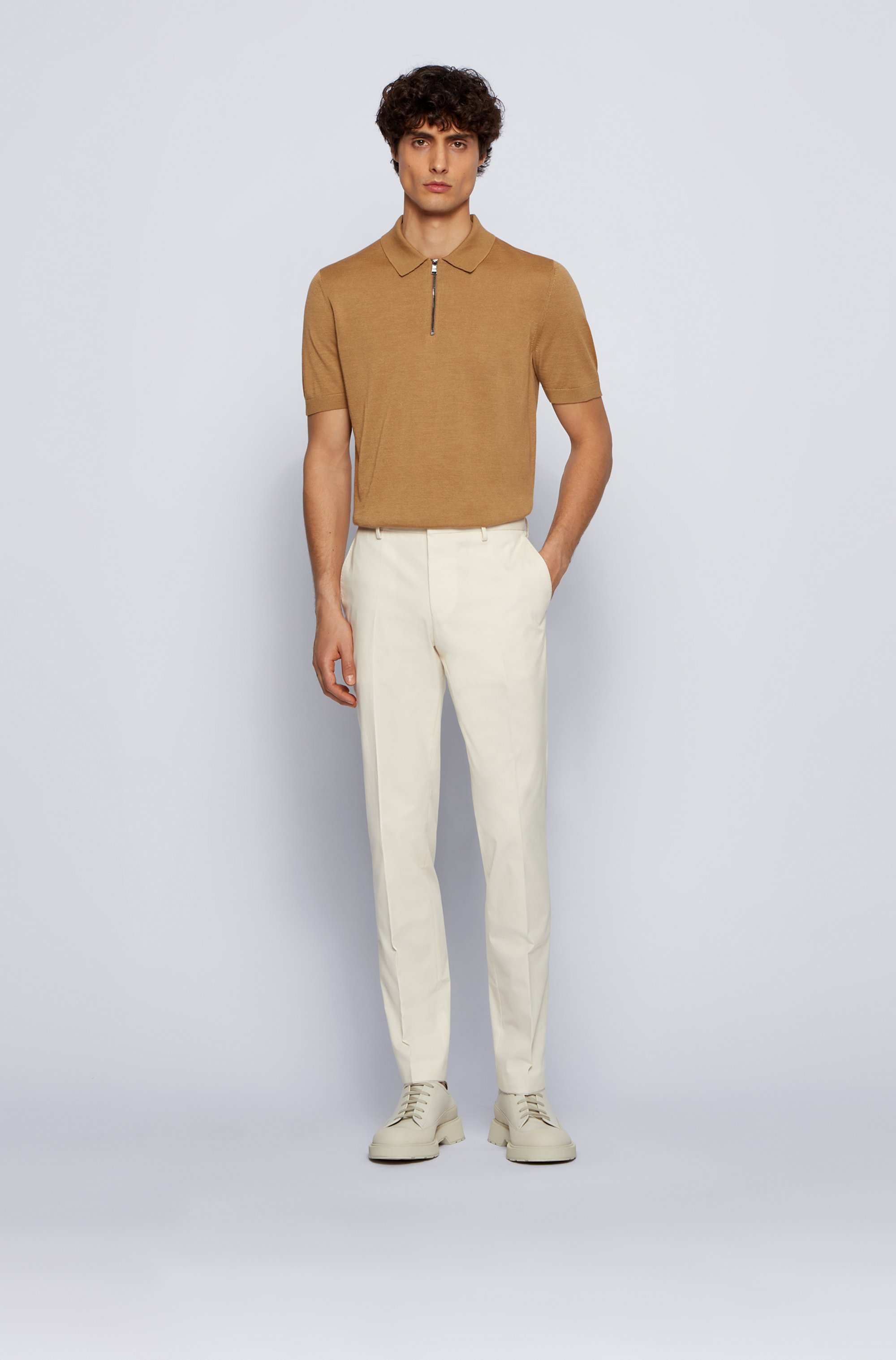 Short-sleeved polo sweater with zipped neck