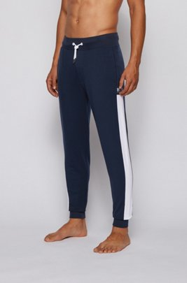 French-terry tracksuit bottoms with side stripes, Dark Blue