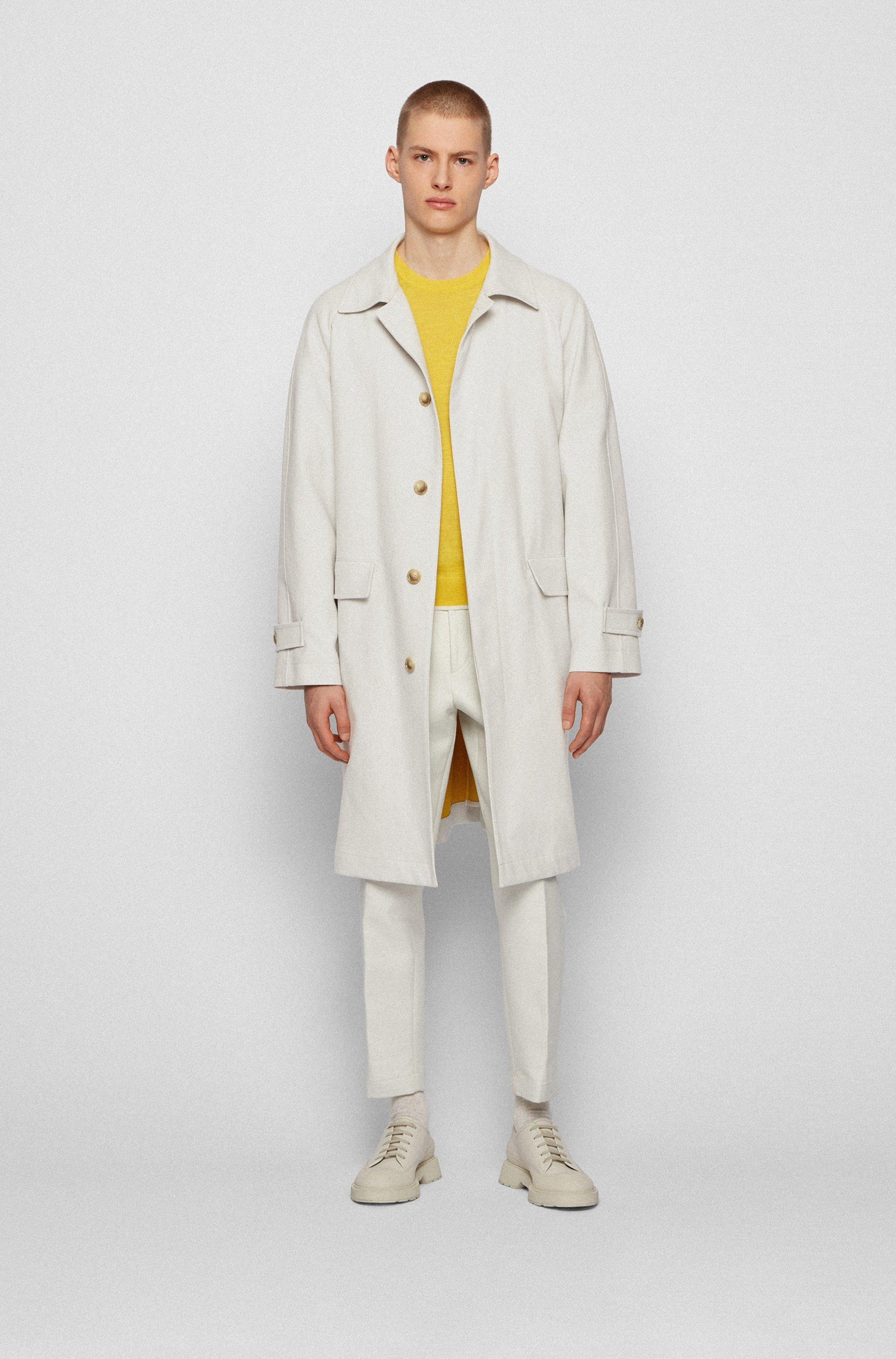 Abrigo relaxed fit de algodón aglomerado con cierre oculto