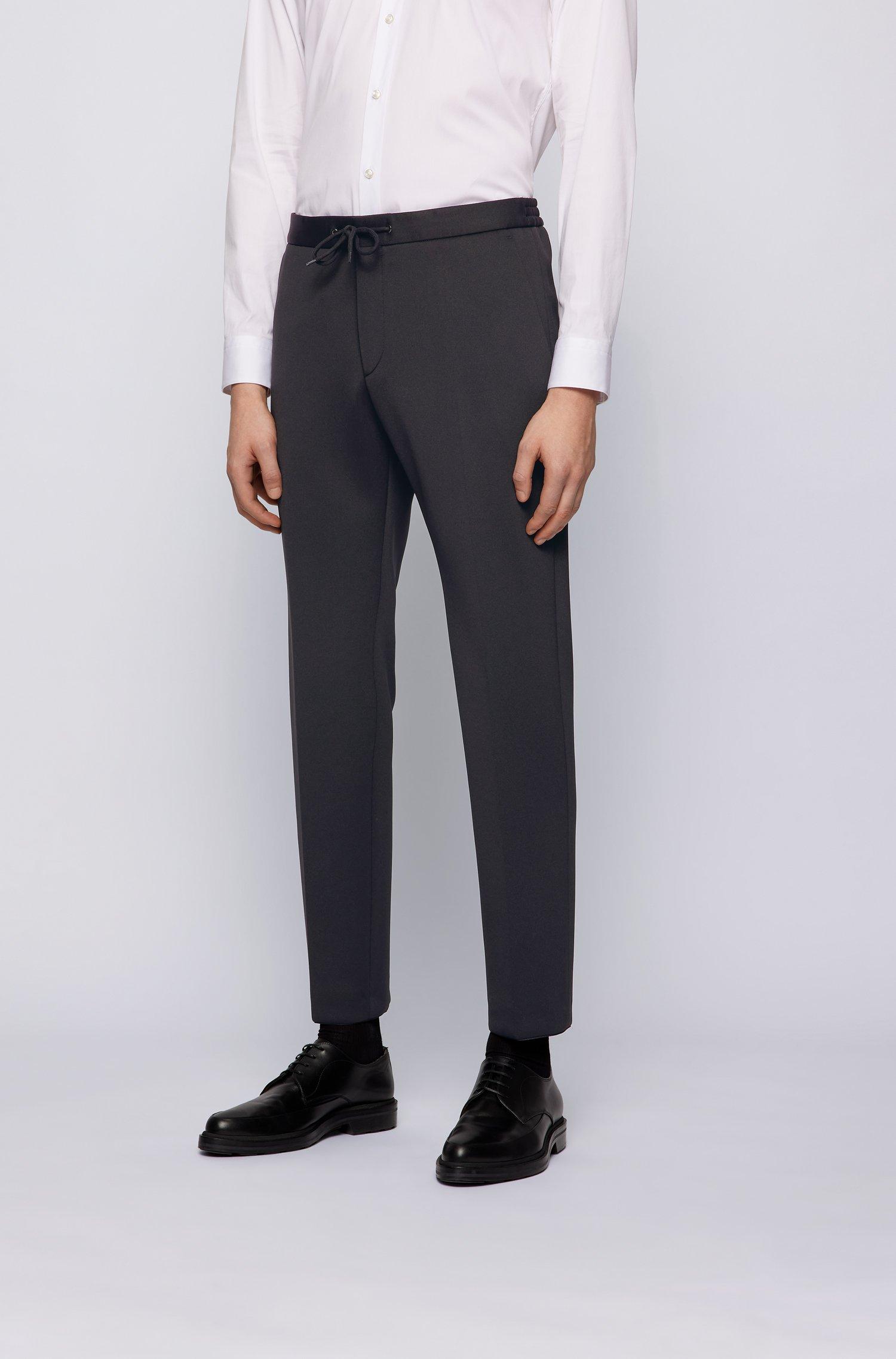 Slim-Fit Hose aus Stretch-Gewebe mit Tunnelzugbund, Schwarz