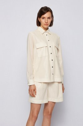 Faux-leather perforated blouse with branded press studs, White