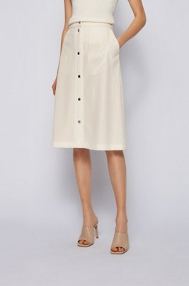 A-line skirt in perforated faux leather with press studs, White