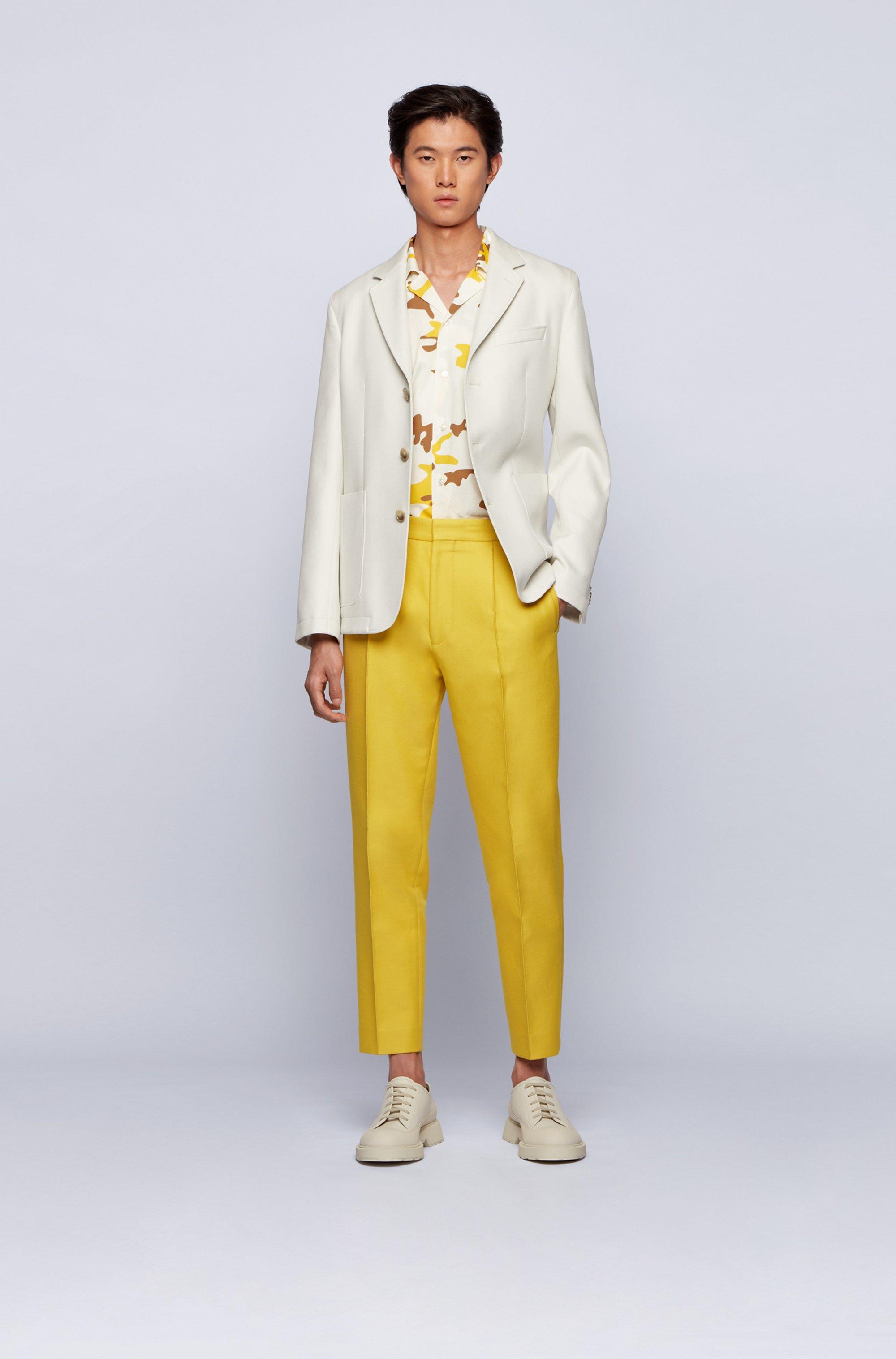 Pantalon coupe droite en pur coton à plis marqués