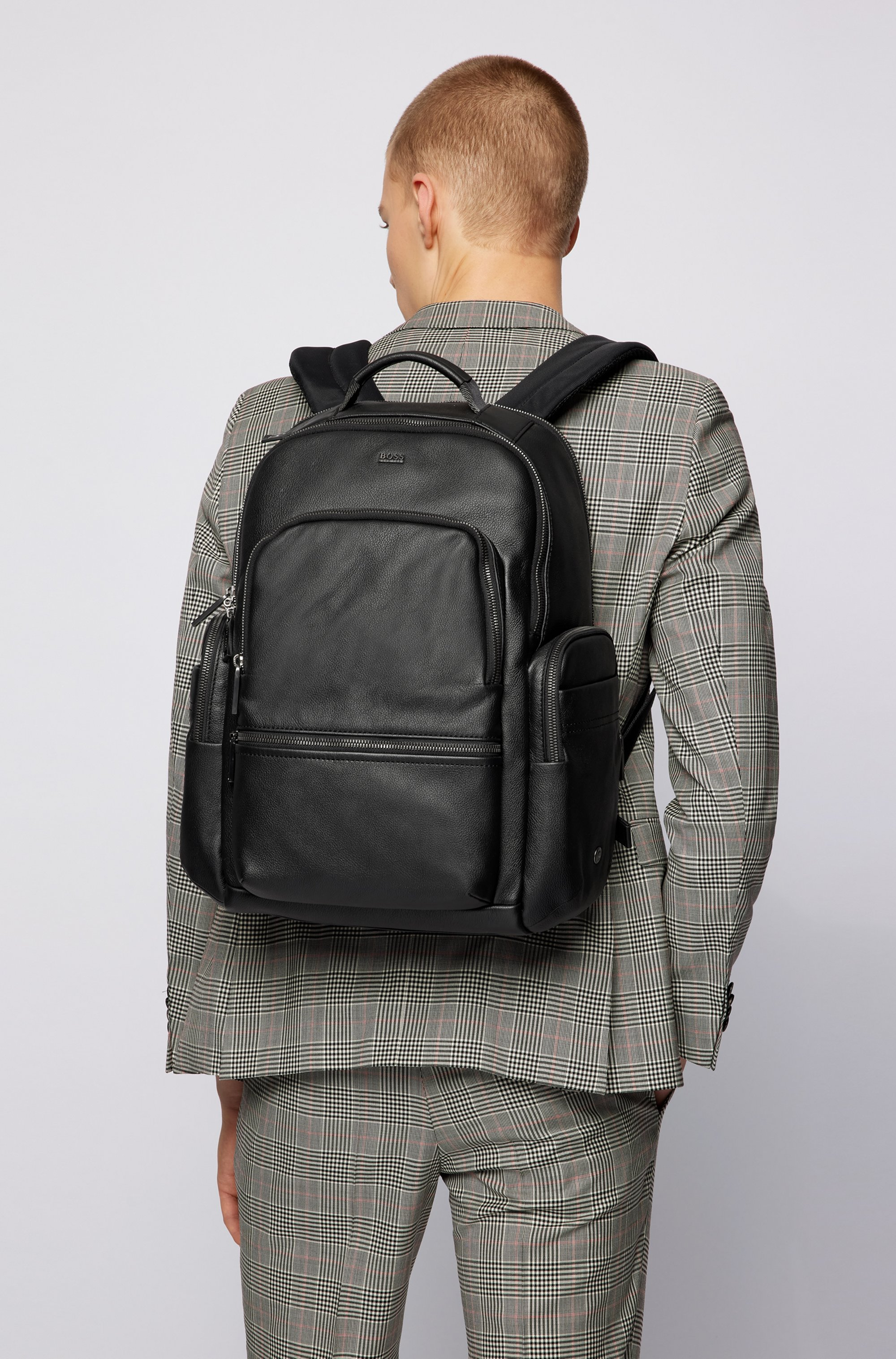 Smooth-leather backpack with multiple pockets