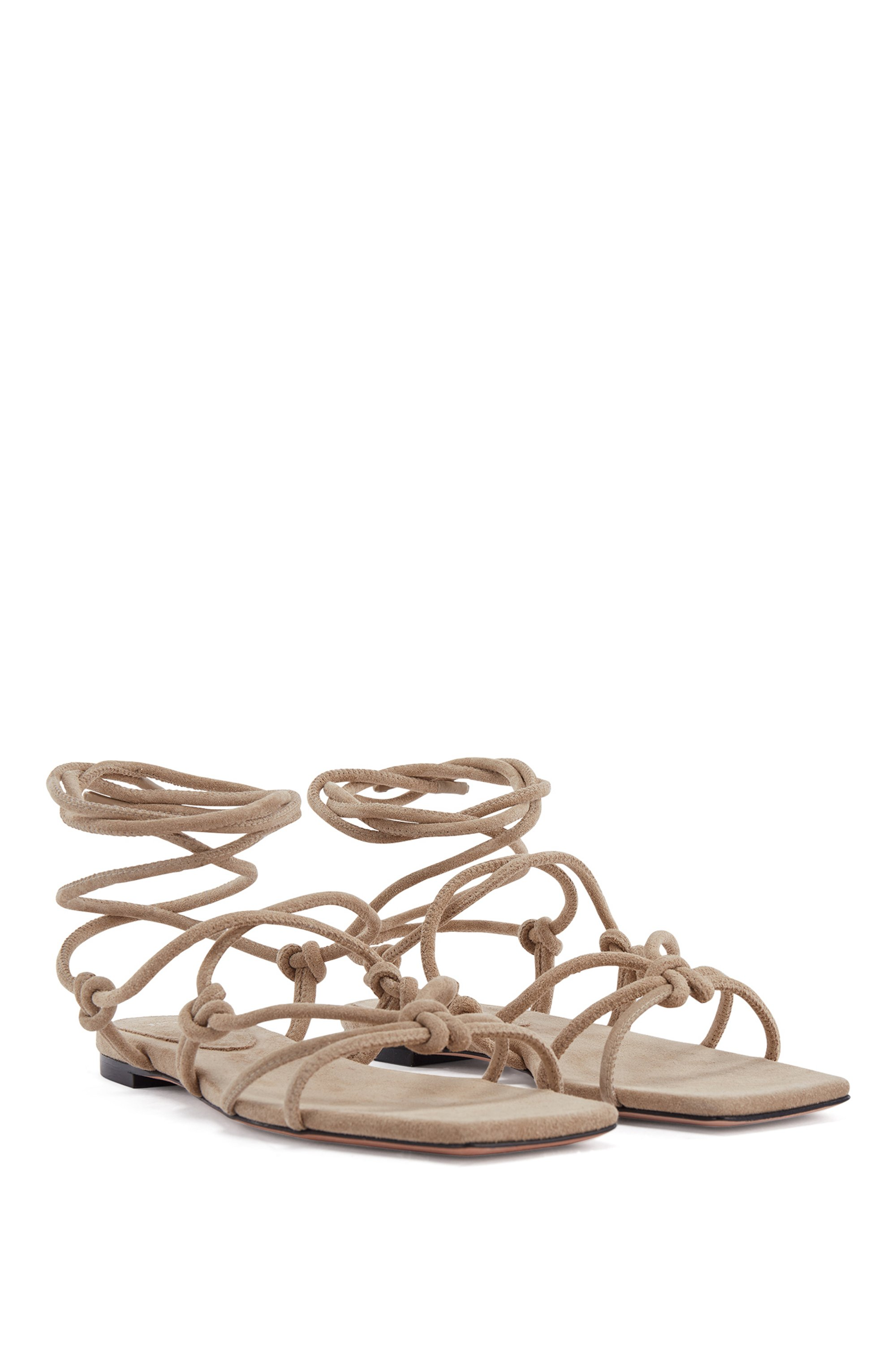 Flat sandals in Italian suede with tie-up straps
