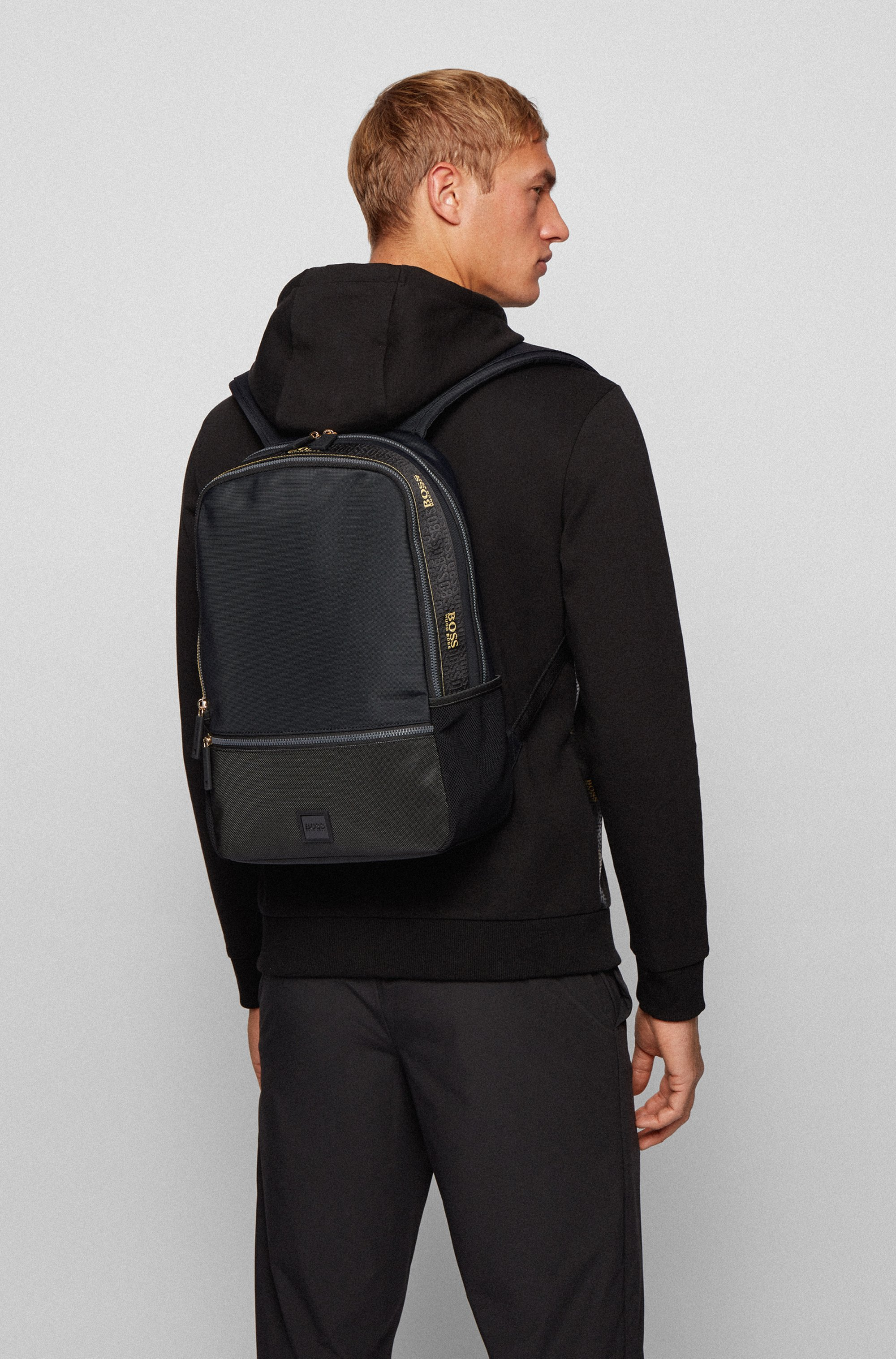 Backpack in recycled fabric with woven logo trim