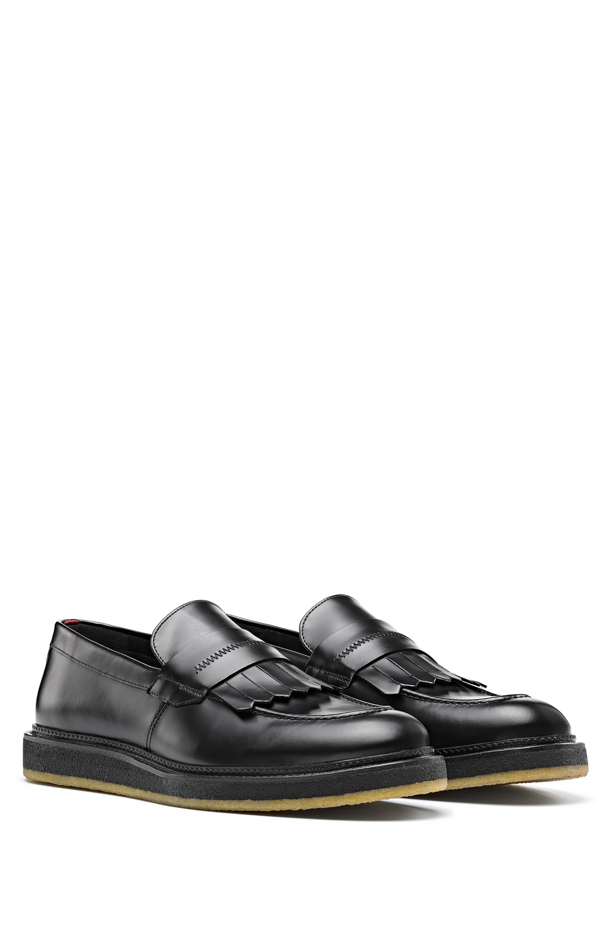 Loafers in polido leather with fringed trim